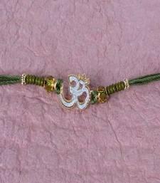 Buy Crystal Beads with Om Rakhi divine-rakhi online