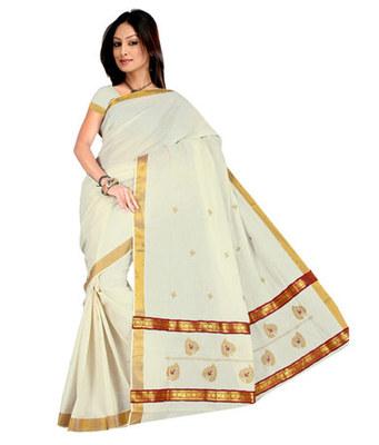 kasavu saree with golden border . Munthi enhanced with brocade laces.
