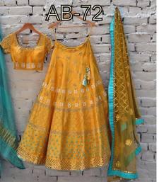 Buy Yellow embroidered Silk Semi stitched lehenga Choli lehenga-choli online
