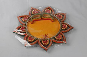 Flower shaped pooja thali with two bowls for roli and chawal