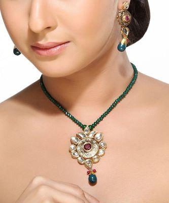 Kundans Ruby and Emerald Pendant Set