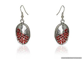 Kshitij Jewels Red Stone Studded Silver Oval Earrings